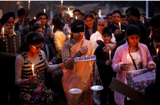 The blind Lady of Justice and lit candles in New Delhi