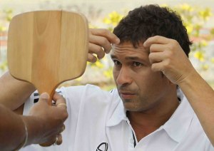 Tendulkar adjusting his locks before a prize distribution ceremony
