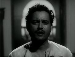 Guru Dutt as the poet in 'Pyaasa' a role loosely modeled after Sahir Ludhianvi