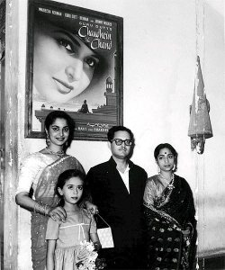 Guru Dutt flanked by the two women in his life; the little girl in the picture is Baby Farida.