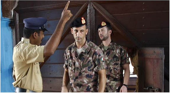 In this, April 22, 2012 file photo, an Indian policeman directs Italian marines Massimiliano Latorre and Salvatore Girone as they come out at the central prison, Trivandrum, where the two marines were detained.